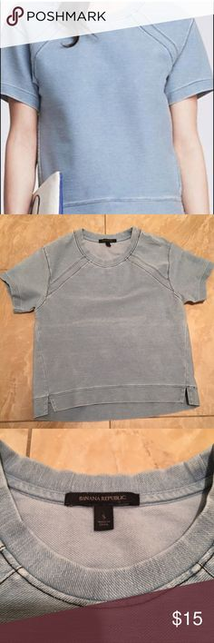 Banana Republic Short Sleeve Sweatshirt Banana republic short sleeve sweatshirt size small. I am 5'5, 125lb, and it fits me perfectly. It's blue/Grey in color . 98% cotton, 4% spandex elastane. Sits right at the waist line. Mint condition. Only worn once. Will ship same day. Banana Republic Tops Sweatshirts & Hoodies