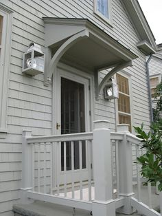 exterior-door-overhang-martha-stewarts-home-in-bedford-new-york-katonah – bedford gray – house and trim one color – best exterior paint colors Front Door Overhang, Best Exterior Paint, Back Doors, Door Awnings, Door Overhang, House With Porch, Building A Porch, Porch Design, Exterior Doors