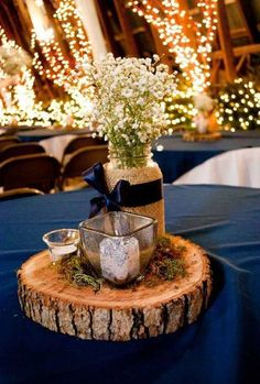 Blue Wedding Flowers centerpiece from our wedding navy blue mason jars filled with babys breath votives and moss Wedding Centerpieces Mason Jars, Mason Jar Centerpieces, Centerpiece Ideas, Western Wedding Centerpieces, Rustic Centerpieces, Photo Centerpieces, Blue Wedding Decorations, Wedding Ideas With Mason Jars, Wood Slice Centerpiece