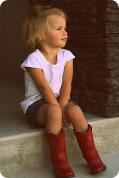 Red cowboy boots on a little lady. Adore!