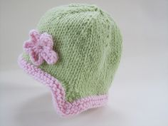 A sweet little cap with pointed flaps, knit in the round. Choose a soft Chunky yarn and knit up a quick gift.