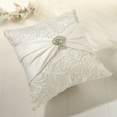 This beautiful Ivory Lace Ring Bearer Pillow is a lovely addition to your wedding ceremony.  The ivory satin ring pillow is covered in ivory lace for a vintage or antiqued look.  Measures 7 inches squ