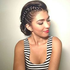 An elegant braided bun + red lip = winter party perfection.