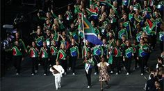 Caster Semenya of the South Africa Olympic team carries her country's flag during the Opening Ceremony
