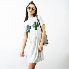 Super cute soft jersey dress with cactus detail. Green leatherette appliqued and embroidered prickles. Soft cotton marl grey jersey, hangs really well, easy to
