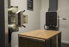 Spinal Imaging Center: Reclaimed wood box built to cover x-ray generator. This box also dubs as a table for consent forms. #diy #affordablebuilding #gonsteadchiro #industrial