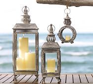 19th-century French gas lamps were the muse behind these striking iron lanterns. Intricate details such as finial tops, filigreed frames and a softly weathered finish give them rich character.  Graham Metal Lanterns #potterybarn