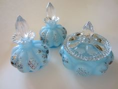 "Charleton by Fenton vanity Baby blue, melon turquoise perfume collection. From early 1940. hand decorated, painted, gold & silver flowers. clear ornate dome stoppers. 5"" h., 3.5"" d. powder 4.5"". total"