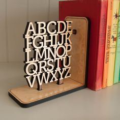 Alphabet Wooden Bookend from Graphic Spaces. Keeps books tidy and helps kids learn the alphabet. Love it!