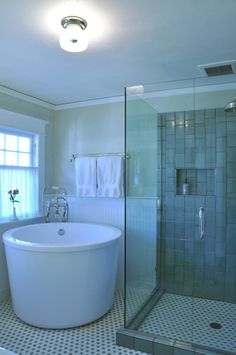 Adorable Bathrooms With Japanese Soaking Tub : Elegant Bathroom Design Inspiration With White Round Shaped Japanese Soaking Tub Along With Glass Shower Enclosure Along With Ceiling Light Along With Polka Dot Ceramic Floor Tiles Along With Towel Rods