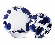 Here's one truly elegant dinnerware set! Handmade and crafted from porcelain, it counts 16 pieces including 4 dinner plates, 4 side plates, 4 bowls and 4 cups. The set features hand-painted floral patterns on a white background, which adds finesse to the Holiday Gift Guide, Holiday Gifts, Side Plates, Dinnerware Sets, Dinner Plates, Indigo, New Homes, Dishes, Tableware