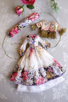 Recycle vintage hankerchiefs into stunning treasures. This ensemble would be great on an antique wooden clothespin doll or hung on a tree as it.  Image found at http://www.flickr.com/photos/53737352@N05/8158683886#