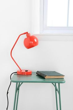 You don't need too much. Just a simple quiet place to call your own. Love the pop of colour with the lamp