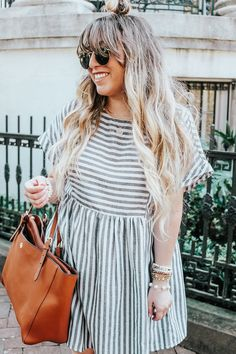 Sharing an easy breezy striped dress for summer and how I'm prepping to move to Savannah! Get lifestyle, fashion and beauty inspiration here.