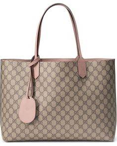 Gucci's signature double-G print reverses to smooth, solid leather on a top-handle tote made doubly fabulous for its versatility. Style Name: Gucci Medium Turnaround Reversible Leather Tote. Style Number: Available in stores. Classic Handbags, Best Handbags, Purses And Handbags, Gucci Tote Bag, Gucci Bags, Louis Vuitton 2017, Expensive Purses, Luxury Bags, Fashion Bags