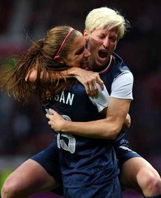 MANCHESTER, ENGLAND - AUGUST 06: Megan Rapinoe celebrates with Alex Morgan of the United States after scoring during the Women's Football Semi Final match between Canada and USA, on Day 10 of the London 2012 Olympic Games at Old Trafford on August 6, 2012 in Manchester, England. (Photo by Stanley Chou/Getty Images)