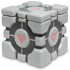 Portal Weighted Companion Cube Cookie Jar. A great new reason to make cookies! (As if there weren't enough reasons before.)