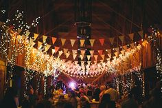 Affordable wedding reception decor - string lights and banners #budget