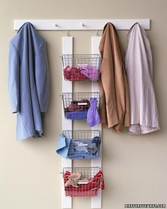 30 Clever storage organization ideas for your home - I love the baskets. May use this for my coat rack in the dining room.