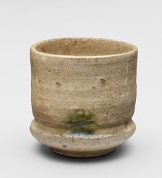 Sake cup Philadelphia Museum of art Period: Momoyama Period (1568-1615), Date: Late 16th - early 17th century  Medium: Mino kiln, Kiseto type  Dimensions: 2 3/8 x 2 1/2 inches (6 x 6.4 cm)