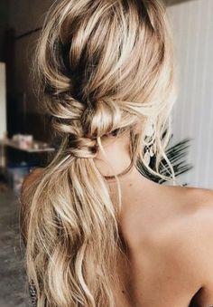 blonde balayage hair + messy french braid into a low bun + romantic curls | long hair ideas