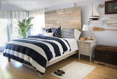 This is definitely my #1 room inspiration pin!!!! I have the same bed cover!! The Thrifty Girl's Guide to Coastal Decor