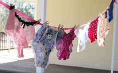 Linens and Lingerie {Wedding Shower} An extra fun and girly element of the party involved lots of pretty panties!!  Each guest was asked to bring a (new) pair of panties (in the bride's size) that represented them. The panties were displayed on ribbon, with mini clothes pins. During the party, the bride was asked to guess which guest brought which pair of panties. Party guests also got to participate, by guessing (ahead of time) how many panties the bride would be able to correctly match.
