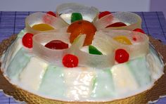 """SICILIAN CASSATA CAKE  The """"Cassata Siciliana"""" is probably the most well known product from Sicily in all the world. Its origin go back to the Muslim Domination in sicily in the IX century. In fact, many products today common in our sunny land, as Lemon, Mandarin and Orange, were once imported by the Muslim. With Ricotta cheese, a dairy product from sheep, the first """"simple"""" version of Cassata was made.  Any population that has dominated Sicily added something.."""