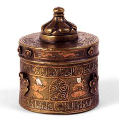 Inkwell, cast, engraved, and punched bronze, inlaid with copper and silver Eastern Iran; 2nd half of 12th century H: 9.5; Diam: 7.5 cm