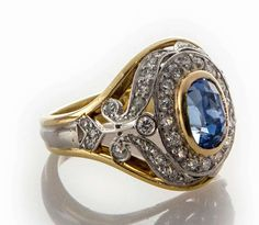 1900s platinum and 18k yellow gold with no-heat natural cornflower blue sapphire surrounded by old european and rose cut diamonds ring