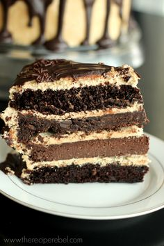 The Ultimate Chocolate Peanut Butter Cake -- two fudgy cake layers, a double chocolate cookie layer and a chocolate cheesecake layer, all covered in peanut butter frosting and chocolate ganache.