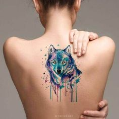 Watercolor tattoo techniques are widely popular now. Watercolor wolf tattoos will look like a painting on your skin. The beautiful colors in the tattoo will bring in both depth and dimension, thereby giving it a unique look. Wolf Eye Tattoo, Simple Wolf Tattoo, Celtic Wolf Tattoo, Howling Wolf Tattoo, Calf Tattoo, Geometric Wolf Tattoo, Tribal Wolf Tattoo, Wolf Tattoo Design, Tribal Tattoos