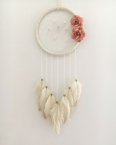 A personal favorite from my Etsy shop https://www.etsy.com/ca/listing/519328214/7-white-floral-dream-catcher