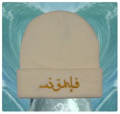 arabic: white beanie, golden embroidery