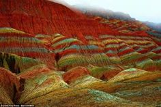 These remarkable pictures show the actual scenery of Danxia Landform at Nantaizi village of Nijiaying town, in Linzhe county of Zhangye, Gansu province of China. Zhangye Danxia Landform, Places Around The World, Around The Worlds, Rainbow Island, Colorful Mountains, Rainbow Mountains, Provinces Of China, Chinese Landscape, Landscape Art