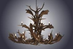 Hand-made antler chandeliers begin with hand selected shed antlers (no deer are killed). All antler products are authentic. Deer Antler Chandelier, Antler Wreath, Antler Lights, Antler Art, Antler Crafts, Rustic Lighting, Modern Lighting, Cabin Lighting, Toilet Roll Craft