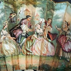 Close up of the painted fan 18th century European vignette with beautiful maidens and gentlemen frolicking in the countryside!  #vintagelove #18thcentury #painting #european #vignette #victorian #fanart #foldingfan #closeup #detail #picoftheday