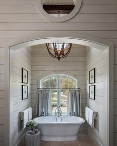 Can you picture yourself escaping from any type of stress in this quiet and welcoming bath #nook? I would #love that! Design by @_wrightdesign_. #shiplap #farmhousebathroom #bathroomgoals #relaxing #orb #orbchandelier #lighting #bathroomremodel #bathroomdesign #bathroomreno #bathromminspo #inspo #interiors #inteiroroftheday #inspire_me_home_decor #interiordesign #picoftheday #followers #iggoals