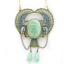 A Egyptian revival plique-à-jour enamel and amazonite scarab pendant/brooch, circa 1920, with modern fourteen karat gold chain -   carved amazonite scarab flanked to either side with stylized peacocks, each with an outstretched wing and suspending an amazonite drop; mounted in silver; chain length: 16 1/8in.; pendant length: 3in.