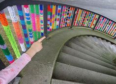 Rainbow stair rail yarn bombing