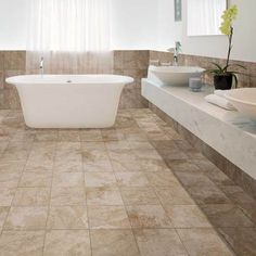 Check out this American Olean product: Stone Claire in Bluff 13 x 13 in a grid pattern on the floor with 10 x 14 wall tile and 3 x 3 mosaic on the wall