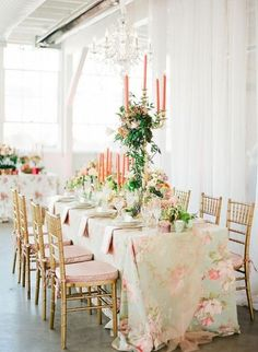 all of this is beautiful, it appears to be in a loft or very open industrial space. the draping of the fabric softens all the light from the big windows the gold chairs the candles. all of this is perfect.via:weddingomania/ comments:walkin'onsunshine:)