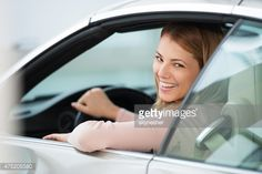 Stock Photo : Beautiful smiling woman in a car looking at camera.