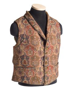 """This """"paisley"""" vest belonged to Charles Manigault (1795-1874), probably c. 1840. One shows a fairly traditional boteh pattern and is printed while the other is woven with an elaborate repetition of """"exotic"""" temples. The paisley one has corded edging and pocket openings; the temple vest has a woven tape binding on the edges and pockets. The paisley example has covered buttons, the temple one has 8 small brass buttons."""