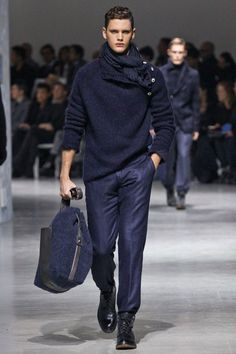 Corneliani: Milan Men Fashion Week F/W 2012/2013. Blue side button sweater paired with similar blue scarf.