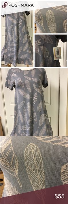 NWT JACQUARD FEATHER CARLY BY LULAROE Major unicorn Carly style dress. Jacquard feathers against a gray background. New with tags.  Note: I am not a consultant, just a customer who loves lularoe and wears it almost daily. I own most styles so feel free to ask any questions and I will try to help. Destashing a bit as my closet is a little full. LuLaRoe Dresses