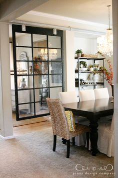 hanging window as a room divider - maybe do this in the open wall between dining room and family room?