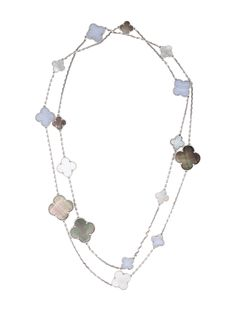 18K white gold Van Cleef & Arpels Magic Alhambra Station Necklace on chain-link featuring graduated stations of black mother of pearl slices, white mother of pearl slices and blue lace agate with box clasp closure. Includes box and jewelry pouch.  Note: This item has been appraised and inspected by our certified gemologist. All diamond and gemstone grading is done under GIA standards as the mounting permits. All gemstone weights and measurements are approximate.  Metal Type: 18K White Go...