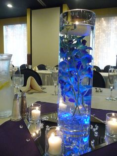 Rolfe Wedding 7/12/14 Rockwoods Banquet Center in Otsego, MN, www.rockwoodsgrill.com, Buttercream Creations Cake in Big Lake, MN, Blue and Purple Orchid Wedding, Submerged Blue and Purple Orchids with a floating candle and sunken blue accent light. Under Water Centerpiece!