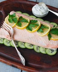 Cold Poached Salmon Recipe on Food & Wine by Andrew Zimmern.  I am going to make this summer.